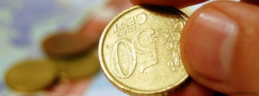 A hand holding a 50 eurocent coin Facebook cover photo