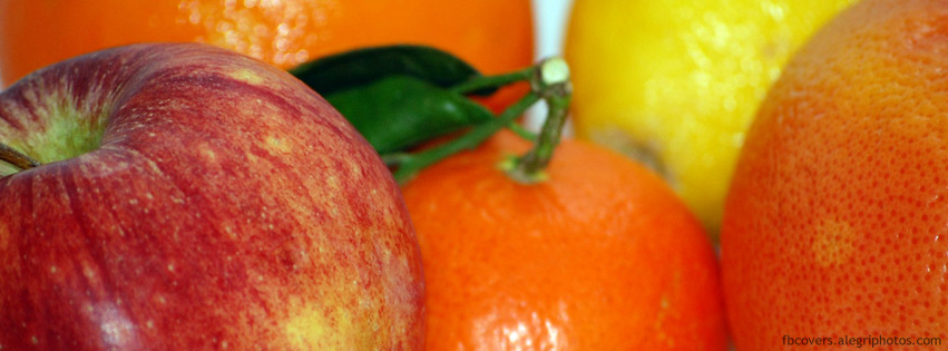 Apple orange lemon and mandarine fruit pile Facebook cover photo