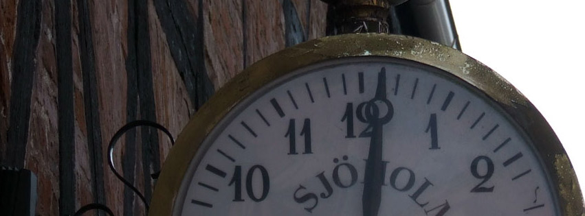 Classic clock on building Facebook cover photo