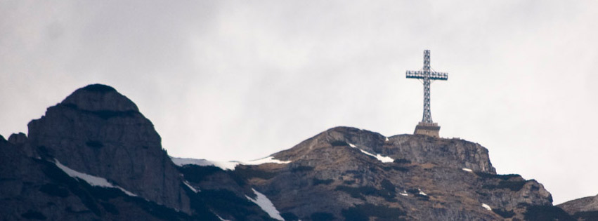Cross on mountain peak Facebook cover photo