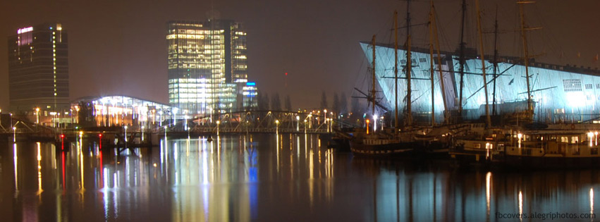 Modern buildings in Amsterdam at night Facebook cover photo