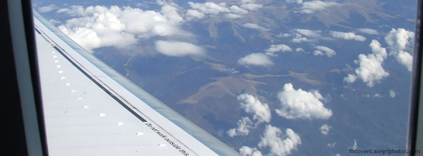 View over airplane wing Facebook cover photo